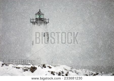 Portsmouth Harbor Lighthouse, Flashes A Green Light During A Winter Snowstorm Along The Holidays In