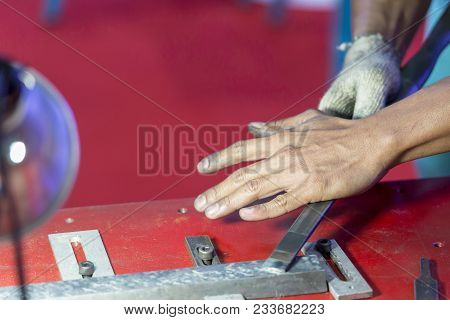 The Craftsman Making The Scraping Process For Make Flatness On The Slide-way Of Grinding Machine.