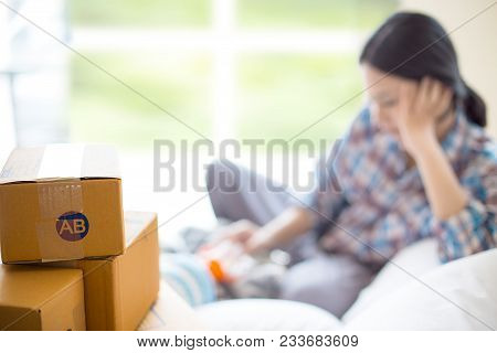 Selective Focus At Packaging And Blurred Background With Pretty Single Mom Is Feeding Milk From Bott