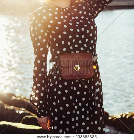 Spring Summer Casual Female Outfit With Long Black Dress In Polka Dots With Leather Brow Purse Belt