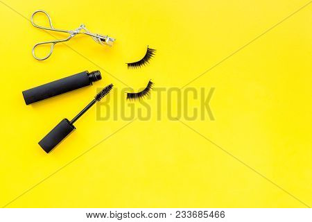 Makeup Set For Expressive Eyelashes. Mascara, False Eyelashes, Eyelash Curler On Yellow Background T