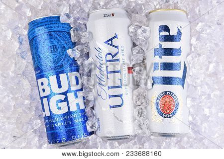 Irvine, California - March 29, 2018: Three Of The Most Popular Light Beers In A Bed Of Ice. King Can