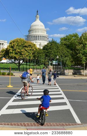 Washington D.C. / United States - August 16 2014: Tourist bikes in front of the Capitol Building in springtime - Washington DC USA