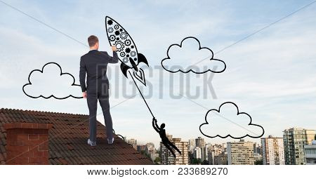 Digital composite of Rear view of businessman on roof drawing rocket in midair