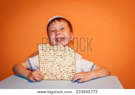 Happy Little Jewish Child With A Kippah On His Head Looking Forward For The Jewish Holiday Of Pessac