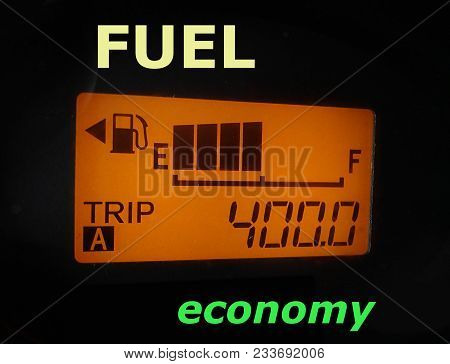 Fuel Economy: Fuel Gauge And Odometer Showing A Minimal Fuel Consumption