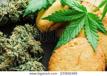 Cbd Cookies With Cannabis And Buds Of Marijuana On The Table. A Can Of Cannabis Buds Concept Of Cook