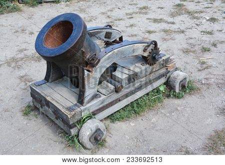 A Mortar Is A Device That Fires Projectiles At Low Velocities And Short Ranges. Old Rusty Mortar Or