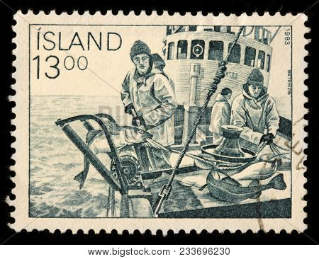 Luga, Russia - January 16, 2018: A Stamp Printed By Iceland Shows Fishermen On The Icelandic Fishing