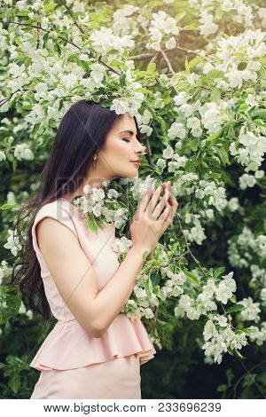 Perfect Young Woman Smelling Flower In Blossom Spring Flowers Garden Background