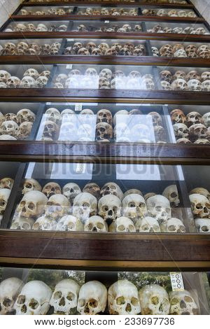 Phnom Penh, Cambodia - 17 January 2018: The Skulls Of Torture Victims Resting In A Stupa At The Kill