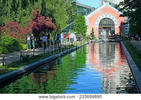 Moscow, Russia - July 6, 2017: People Walking Around A Pond In A Botanical Garden In The Center Of M