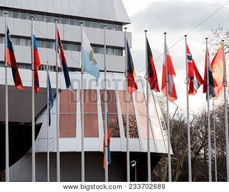 Detail Of Russia Flag Flying Half-mast Between Eu Flags At Council Of Europe As A Tribute And Mourni