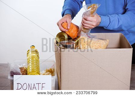 Homeless Poor Man Holding Carton Board With Word Please Help For Donations