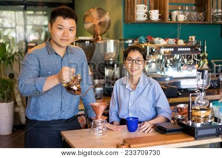 Modern Asian Couple Making Best Coffee In Town. Content Confident Young Family Running Own Business.