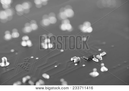 Circuit board with resistors microchips and electronic components. Electronic computer hardware technology. Integrated communication processor. Information engineering component. Selective focus. poster