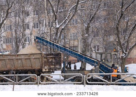 Snow Cleaning Tractor Snow-removal Machine Loading Pile Of Snow On A Dump Truck. Isolate. Snow Plow
