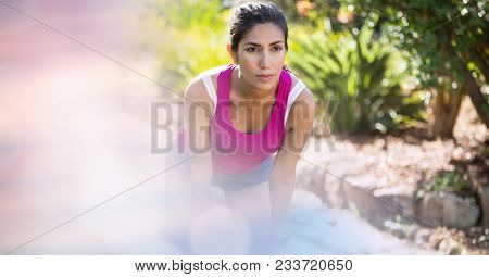 Digital composite of Female jogger looking away in park