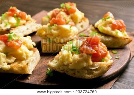Scrambled Eggs On Toasted Bread With Green Onion And Tomato. Close Up View