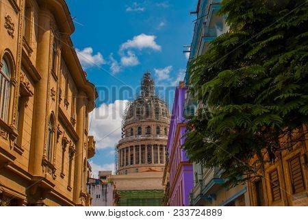 Capitolio Nacional, El Capitolio On Blue Sky Background With Clouds In The Distance On The Backgroun