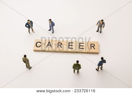 Miniature Figures Businessman : Meeting On Career Word By Wooden Block Word On White Paper Backgroun