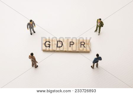 Miniature Figures Businessman : Meeting On Gdpr Letters By Wooden Block Word On White Paper Backgrou