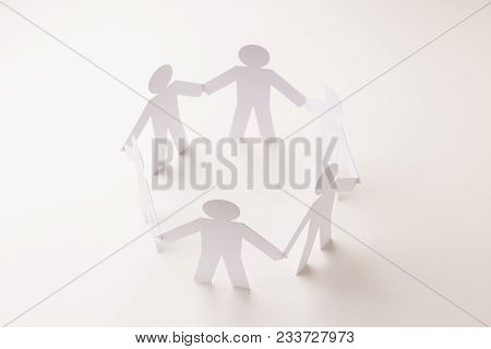 Closed Joining Of Six  Paper Figure In Hand Down Posture On Bright White Background. In Concept Of B