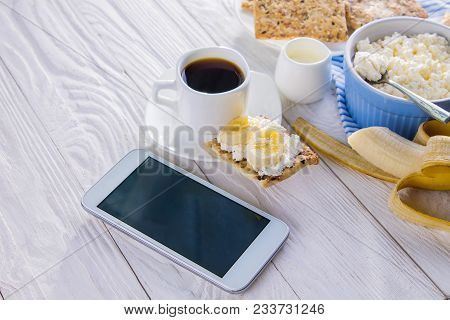 Healthy Organic Breakfast While Using Smartphone. Having Breakfast Using Technologies. Healthy Break