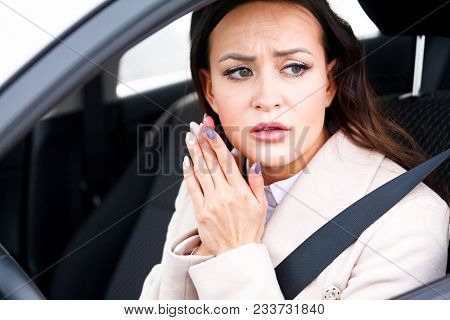 Closeup shot of stressed young woman driver in a car