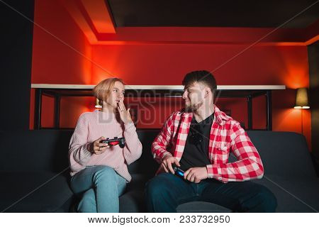 Young Beautiful Couple Chatting While Playing On The Console. Beautiful Young People Spend Time Play