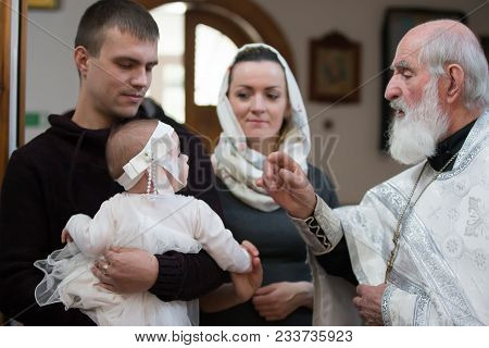 Belarus, Gomel, 25 March. 2018. The Prudhkovsky Church.baptism Of The Child. Godfather And Mother At
