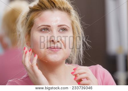 Facial Dry Skin And Body Care, Complexion Treatment At Home Concept. Young Woman Having Gel Peel Off