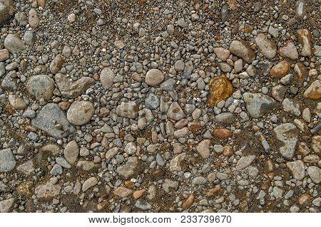 Rock Background. Stony Soil. Earth Texture. Nature Background. Ground And Stones. Smooth Stones