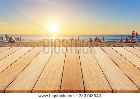 Wooden Board Or Table And Abstract Blurred Background. Free Space Can Be Used For Photo Montage Or P
