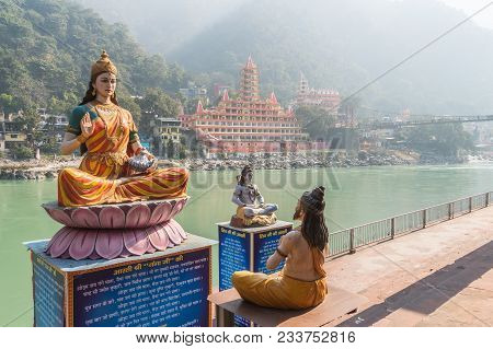 Sculptures Of The Ganges, Shiva And The Wise Man On The River Bank In Rishikesh.10 January 2018. Ris