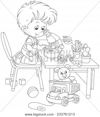 Little Boy As A Researcher And Biologist Looking At A Small Green Leaf Through A School Microscope,