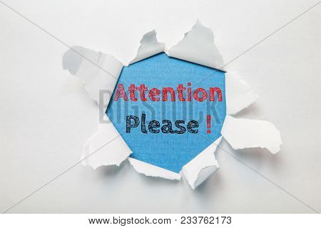 Text Message Attention Please On Torn Paper Background.