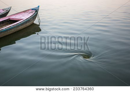 Funnel whirlpool in the water of the Ganges river, Varanasi, India.