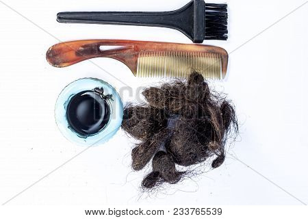 Damaged And White Female Hairs With An Black Hair Coloring Brush And A Bowl Of Hair Dye With A Comb