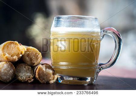 Popular Indian/asian Ganne Ka Ras Or Sugar Cane Or Saccharum Officinarum Juice In A Transparent Glas