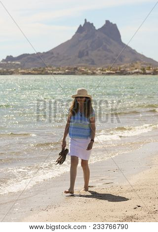 San Carlos, Mexico, March 12. The Beach On March 12, 2018, In San Carlos, Mexico. A Woman Walks The