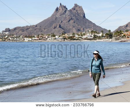 San Carlos, Mexico, March 13. The Beach On March 13, 2018, In San Carlos, Mexico. A Woman Walks The