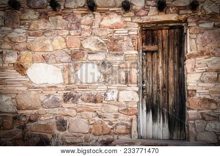 A Wood Door On A Historic Southwest Style Building With Copy Space.
