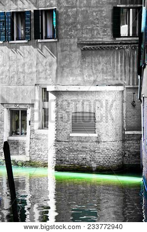 An Empty Canal In Venice With A Sliver Light In A Selective Color Of Green.