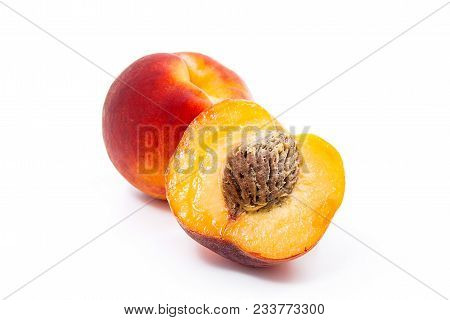 Ripe Peach Fruit And A Half Isolated On White Background.