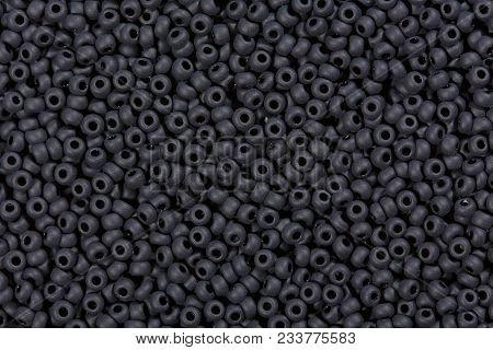 Many Black Glass Beads, Background. High Resolution Photo