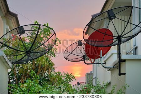 Satellite Dish And Antenna Tv On The House Roof.satellite Receiver And Other Telecommunications On T