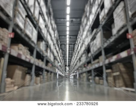 Abstract Blurred Photo Of Warehouse Or Storehouse Industrial And Logistic Company.warehousing On The