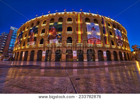 Valencia, Spain - 3/30/2018: The Bullring In Valencia, Spain During The Blue Hour With Banners Poste
