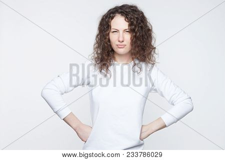 Headshot Of Serious Young European Female Wearing White T-shirt Looking At Camera, Her Eyes Full Of
